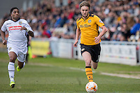 Genaro Snijders of Notts County and Scott Barrow of Newport County during the Sky Bet League 2 match between Newport County and Notts County at Rodney Parade, Newport, Wales on 30 April 2016. Photo by Mark  Hawkins / PRiME Media Images.