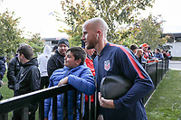TORONTO, ON - OCTOBER 15: Michael Bradley #4 of the United States posses with a fan during a game between Canada and USMNT at BMO Field on October 15, 2019 in Toronto, Canada.