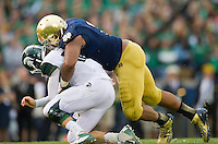 Stephon Tuitt (7) sacks Michigan State Spartans quarterback Connor Cook (18) in the fourth quarter.