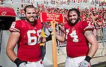 Wisconsin Badgers offensive linemen Gabe Carimi (68) and John Moffitt (74) pose with the Paul Bunyan Axe after defeating the Minnesota Golden Gophers after an NCAA college football game on October 9, 2010 at Camp Randall Stadium in Madison, Wisconsin. The Badgers beat the Golden Gophers 41-23. (Photo by David Stluka)