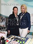 Caroline Price, manager and Laura Finnegan from Bradley's Pharmacy at the Ardee Rural Economic Development Zone (REDZ) Business Showcase held in Ardee parish centre. Photo:Colin Bell/pressphotos.ie