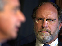 U.S. Senator Jon Corzine (R) listens as U.S. Senator Robert Torricelli (L), announces he is dropping out of the US Senate race, Monday, Sept. 30, 2002, in Trenton, New Jersey. (Photo by William Thomas Cain/photodx.com)