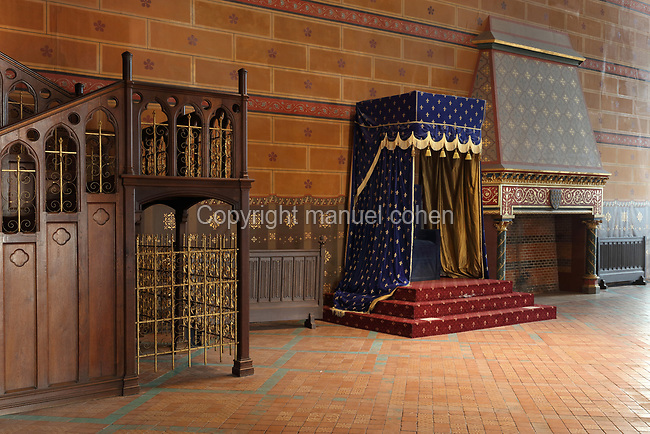 Dais, throne and staircase in the Salle des Etats Generaux, or Estates General Room, built in 1214 in Gothic style under Thibaut VI, Count of Blois-Champagne, in the Chateau Royal de Blois, built 13th - 17th century in Blois in the Loire Valley, Loir-et-Cher, Centre, France. The large hall is covered by a wooden frame forming 2 naves, supported by 6 arches on 5 columns. In 1861-66 Felix Duban restored the room in Neo-Gothic style, painting the vaulted ceiling with a fleur de lys design. The hall is named after the 2 Estates General of Blois in 1576 and 1588, called by Henri III. The chateau has 564 rooms and 75 staircases and is listed as a historic monument and UNESCO World Heritage Site. Picture by Manuel Cohen