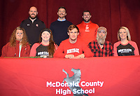 RICK PECK/SPECIAL TO MCDONALD COUNTY PRESS<br /> Joseph Brown III (front, center) recently signed a letter of intent to play baseball at North Arkansas College in Harrison, Ark. Front row, left to right: Sue (mom), Kendra (sister), Joseph Brown III, Joe (dad) and Kristy (sister). Back row: MCHS coaches: Bo Bergen, Kevin Burgi and Kellen Hoover.