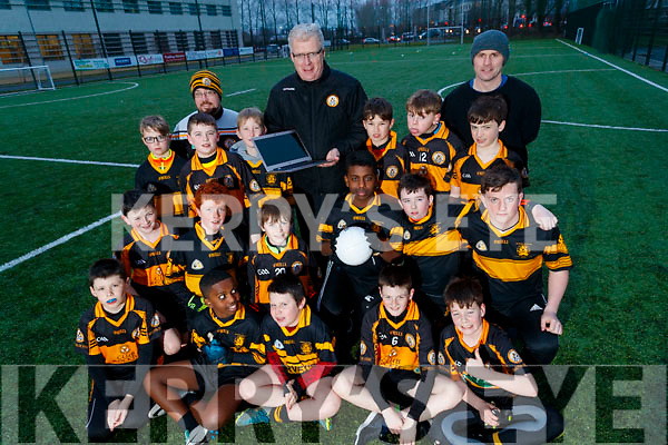 Austin Stacks Chairman Liam Lynch celebrates winning their their second MacNamee award for their Stacks 100 website along with coaches Ronan Kavanagh and William Kirby and the Austin Stacks U-12 team.