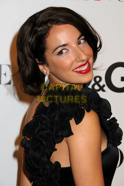 VANESSA LENGIES .7th Annual Teen Vogue Young Hollywood Party held at Milk Studios, Los Angeles, California, USA,.25th September 2009..portrait headshot black ruffles red lipstick   side looking over shoulder one .CAP/ADM/BP.©Byron Purvis/AdMedia/Capital Pictures.