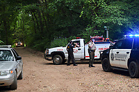 NWA Democrat-Gazette/CHARLIE KAIJO Officers direct traffic, Friday, July 5, 2019 on the intersection of Crossover Rd and Gorden Hollow Rd in Gravette. <br /> <br /> Police responded to a shooting situation that left four people dead in an apparent murder suicide on a nearby property. All four people are related or lived at the residence. One body was found on the driveway. Authorities do not believe there is a danger to the public.