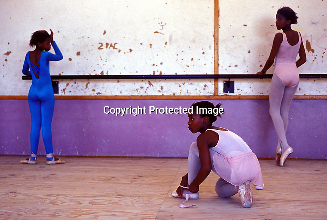 didance00109.Dance. Students during a ballet class in the Dance for All program on at Yomelela primary school on October 27, 2003 in Khayelitsha outside Cape Town, South Africa. The program was started by the Cape Town City Ballet and has helped unprivileged children in the poor townships to a better education and something good to do after school. They train in a classroom. .©Per-Anders Pettersson/iAfrika Photos