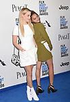 SANTA MONICA, CA - FEBRUARY 25: Actresses Riley Keough (L) and Sasha Lane attend the 2017 Film Independent Spirit Awards at the Santa Monica Pier on February 25, 2017 in Santa Monica, California.