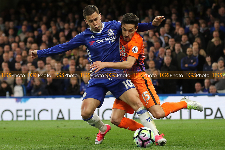 Eden Hazard of Chelsea tries to shield the ball from Manchester City's Jesus Navas during Chelsea vs Manchester City, Premier League Football at Stamford Bridge on 5th April 2017