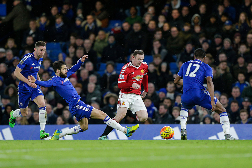 Manchester United's Wayne Rooney evades the diving challenge of Chelsea's Cesc Fabregas<br /> <br /> Photographer Craig Mercer/CameraSport<br /> <br /> Football - Barclays Premiership - Chelsea v Manchester United - Sunday 7th February 2016 - Stamford Bridge - London<br /> <br /> &copy; CameraSport - 43 Linden Ave. Countesthorpe. Leicester. England. LE8 5PG - Tel: +44 (0) 116 277 4147 - admin@camerasport.com - www.camerasport.com