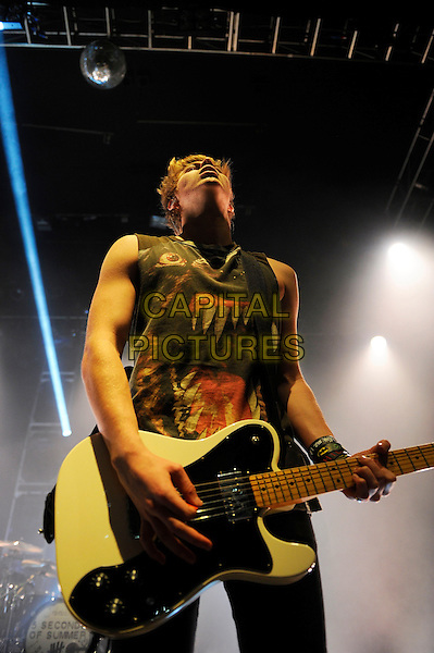 LONDON, ENGLAND - March 3: Luke Hemmings of 5 Seconds Of Summer performs in concert at the o2 Shepherd's Bush Empire on March 3, 2014 in London, England<br /> CAP/MAR<br /> &copy; Martin Harris/Capital Pictures
