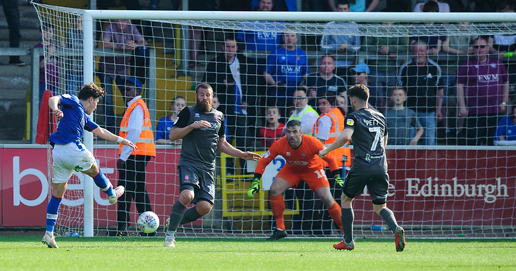 Lincoln City's Michael Bostwick blocks a shot from Carlisle United's Callum O'Hare<br /> <br /> Photographer Chris Vaughan/CameraSport<br /> <br /> The EFL Sky Bet League Two - Carlisle United v Lincoln City - Friday 19th April 2019 - Brunton Park - Carlisle<br /> <br /> World Copyright © 2019 CameraSport. All rights reserved. 43 Linden Ave. Countesthorpe. Leicester. England. LE8 5PG - Tel: +44 (0) 116 277 4147 - admin@camerasport.com - www.camerasport.com
