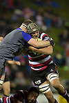 Matiaha Martin gets tackled by Kieran Read. The game of Three Halves, a pre-season warm-up game between the Counties Manukau Steelers, Northland and the All Blacks, played at ECOLight Stadium, Pukekohe, on Friday August 12th 2016. Photo by Richard Spranger.