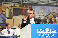 Ken Lewenza, CAW National President, gestures as he speaks during the opening  address on the first day of the 9th Constitutional Convention of the CAW-TAC at the Convention Centre in Quebec city, August 18, 2009.