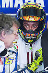 KUALA LUMPUR, MALAYSIA - OCTOBER 24:  Valentino Rossi of Italy listens to mechanics in his pit garage during qualifying for the Malaysian MotoGP, which is round 16 of the MotoGP World Championship at the Sepang Circuit on October 24, 2009 in Kuala Lumpur, Malaysia. Photo by Victor Fraile / The Power of Sport Images