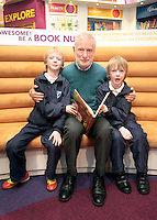 "*** NO FEE PIC*** 01/03/2012 Pictured is Irish Author Brendan O' Brien with third class children from Holy Cross National School Dundrum, Dublin (L to R) Twins Frankie Kelly Corrigan & Charlie Kelly Corrigan (9) at a free reading event of his book "" The Story of Ireland"" in Eason Dundrum to celebrate the 15th annual World Book Day. To celebrate World Book Day Eason, Ireland's leading retailerof books, stationery, magazines & More have teamed up with some of Ireland'sleading children's writers to deliver a series of events in key stores to mark World Book Day. Photo: Gareth Chaney Collins"