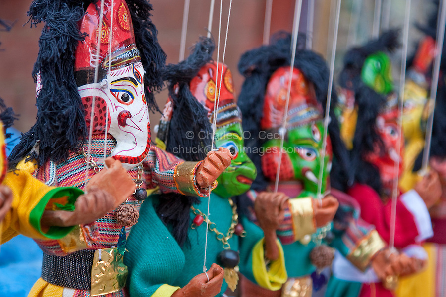 Kathmandu, Nepal.  Dolls of Ganesh, Son of Shiva, and Hanuman, in a Durbar Square Vendor's Shop.