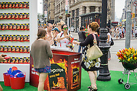 "Popchips promotes their ""Crazy Hot"" flavor snack in Flatiron Plaza in New York on Wednesday, July 1, 2015. The snack company manufactures potato and corn chips using heat and pressure with no oil resulting in a less caloric, healthier snack. Various celebrities have endorsed and invested in the company including Ashton Kutcher and Katy Perry. (© Richard B. Levine)"