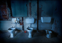 Three derelict lavatories in an abandoned mental asylum
