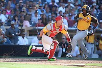 Carson Kelly of the USA Team waits for the ball as Eloy Jimenez of the World Team scores during The Futures Game at Petco Park on July 10, 2016 in San Diego, California. World Team defeated USA Team, 11-3. (Larry Goren/Four Seam Images)