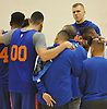 Kristaps Porzingis of the New York Knicks, back right, gathers with teammates during practice at Madison Square Garden Training Center in Greenburgh, NY on Friday, Sept. 28, 2018.