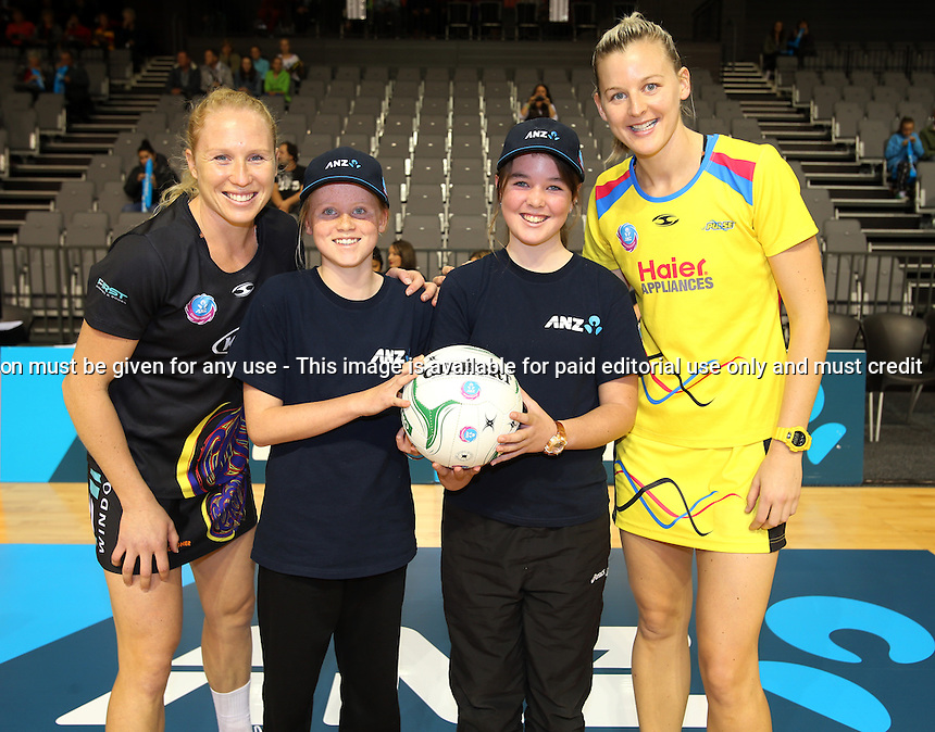 13.05.2013 Magic's Laura Langman with Alexandra Gothorp and Pulse's Katrina Grant with Alana Sankey - during the ANZ Champs netball match between the Magic and Pulse played at Claudelands Arena in Hamilton. Mandatory Photo Credit ©Michael Bradley.