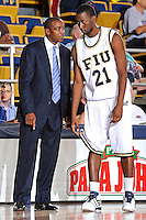 31 December 2009:   FIU Head Coach Isiah Thomas speaks with Cedric Essola (21) in the first half as the South Alabama Jaguars defeated the FIU Golden Panthers, 71-59, at the U.S. Century Bank Arena in Miami, Florida.