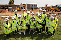 Teachers Hayley Freeman and Pippa Robinson with Chris Frith (right) of the Education Advisory Body with Wainwright Primary Academy School Council pupils, turning the first sod at the ground-breaking ceremony to mark the start of works on their new school.