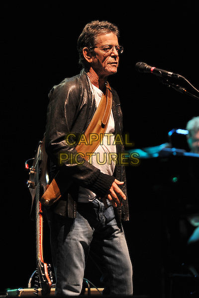 Lou Reed.Performing live at the Hammersmith Apollo, London, England..July 4th, 2011.stage concert live gig performance music half length black leather jacket white top profile glasses .CAP/MAR.© Martin Harris/Capital Pictures.
