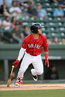Third baseman Everlouis Lozada (4) of the Greenville Drive bats in a game against the Charleston RiverDogs on Friday, April 27, 2018, at Fluor Field at the West End in Greenville, South Carolina. Greenville won, 5-4. (Tom Priddy/Four Seam Images)