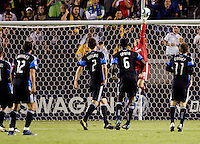 Hard working San Jose Earthquakes goalkeeper Jon Busch (18) just barley pushes the ball over the crossbar as teammates (from l-r) Ramiro Corrales (12), Bobby Burling (2), Ike Opara (6) and Bobby Convey (11) look on. The LA Galaxy and the San Jose Earthquakes played to a 2-2 draw at Home Depot Center stadium in Carson, California on Thursday July 22, 2010.