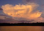 Dramatic clouds mimic a manta ray, Erenang, Kaimana area, Papua.
