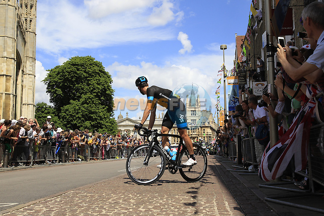 Bernhard Eisel (AUT) Team Sky does a track stand by King's College as he waits for team mate Richie Porte (AUS) in Cambridge before the start of Stage 3 of the 2014 Tour de France running 155km from Cambridge to London. 7th July 2014.<br /> Picture: Eoin Clarke www.newsfile.ie
