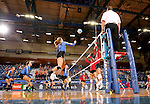 BROOKINGS, SD - SEPTEMBER 25:  Ashlynn Smith #4 from South Dakota State University punches the ball over the net against the University of South Dakota during their match Sunday afternoon at Frost Arena. (Photo by Dave Eggen/Inertia)