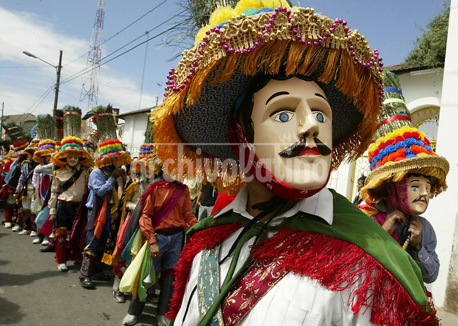 Parishioners called Gueguenses wearing masks dance during the celebration of  Saint Sebastian day , in the city of Diriamba, 28 milessouth from Managua.