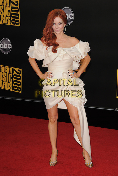 PHOEBE PRICE .The 2008 American Music Awards held at Nokia Theatre L.A. Live in Los Angeles, California, USA. .November 23rd, 2008 .ama amas ama's arrivals full length white cream off the shoulder mini dress train hands on hips ruffled ruffles .CAP/DVS.©Debbie VanStory/Capital Pictures.