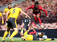 Liverpool's Divock Origi is tackled by Wolverhampton Wanderers' Joao Moutinho<br /> <br /> Photographer Rich Linley/CameraSport<br /> <br /> The Premier League - Liverpool v Wolverhampton Wanderers - Sunday 12th May 2019 - Anfield - Liverpool<br /> <br /> World Copyright &copy; 2019 CameraSport. All rights reserved. 43 Linden Ave. Countesthorpe. Leicester. England. LE8 5PG - Tel: +44 (0) 116 277 4147 - admin@camerasport.com - www.camerasport.com