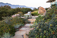 Stone path through California native plant garden, Santa Barbara,
