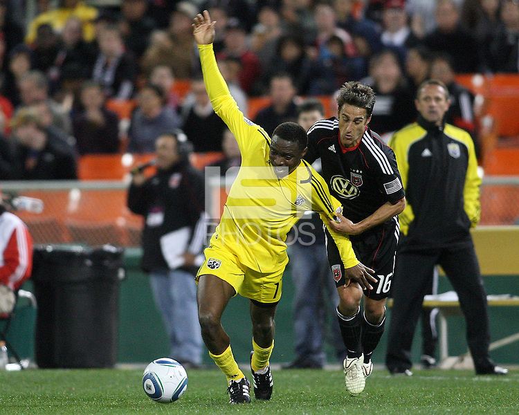 Josh Wolfe#16 of D.C. United grabs Emmanuel Ekpo#17 of the Columbus Crew during the opening match of the 2011 season at RFK Stadium, in Washington D.C. on March 19 2011.D.C. United won 3-1.
