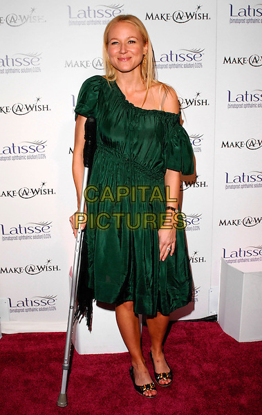 JEWEL (Jewel Kilcher).Launch Party for LATISSE held at a private gallery, Los Angeles, California, USA. .March 26th, 2009 .full length green dress off the shoulder crutch injury wound open toe sandals shoes .CAP/ROT.©Lee Roth/Roth Stock/Capital Pictures