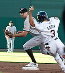 Reno Aces Adam Eaton breaks up a double play by Sacramento River Cats second baseman Adam Rosales during their game on Monday night July 30, 2012 at Aces Ballpark in Reno, Nevada.