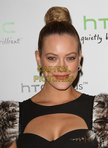 Peta Murgatroyd.The HTC Statusª Social Launch Event held at Paramount Studios in Hollywood, California, USA..July 19th, 2011.headshot portrait black brown feather hair up bun cut out away cleavage pink lipstick make-up .CAP/ADM/KB.©Kevan Brooks/AdMedia/Capital Pictures.