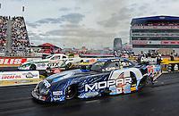 Sept. 5, 2011; Claremont, IN, USA: NHRA funny car driver Matt Hagan (near lane) races alongside Mike Neff during the US Nationals at Lucas Oil Raceway. Mandatory Credit: Mark J. Rebilas-
