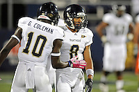 30 March 2012:  FIU's Glenn Coleman (10) congratulates Loranzo Hammonds (8) after he scored a touchdown at the FIU Football Spring Game at University Park Stadium in Miami, Florida.