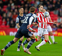 11th January 2020; Bet365 Stadium, Stoke, Staffordshire, England; English Championship Football, Stoke City versus Milwall FC; Nick Powell of Stoke City controls a loose ball - Strictly Editorial Use Only. No use with unauthorized audio, video, data, fixture lists, club/league logos or 'live' services. Online in-match use limited to 120 images, no video emulation. No use in betting, games or single club/league/player publications