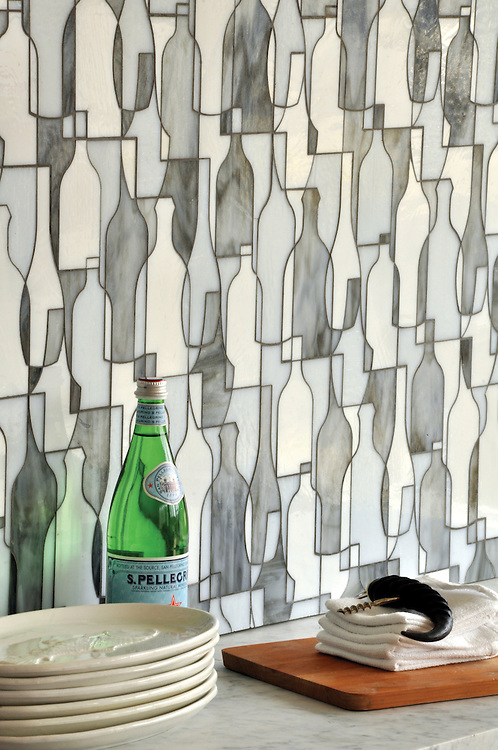 Bottles, a waterjet glass mosaic shown in Moonstone, Opal and Tourmaline, is part of the Erin Adams Collection for New Ravenna.