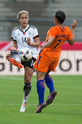 25.10.2016. Aeln, Germany.  Germany's Anna Blaesse (L) and the Nchallenge for the ball during the women's international football match between Germany and the Netherlands in the Scholz Arena in Aalen, Germany, 25 October 2016.