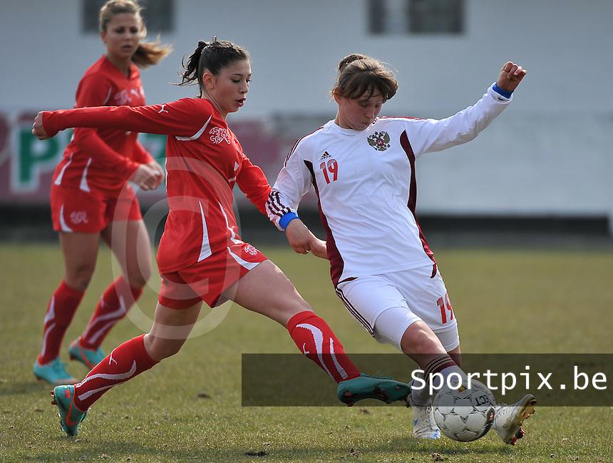 Switzerland U19 - Russia U19 : Alena Zhizhova on the ball before Carmen Pulver (left).foto DAVID CATRY / Nikonpro.be