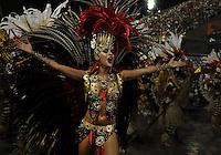 A dancer of Grande Rio samba school performs during parade at the Sambadrome, Rio de Janeiro, Brazil, March 2, 2014.  (Austral Foto/Renzo Gostoli)
